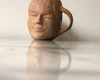 Face mug sculpture pottery, serene smile head pot cup vessel vase teacup bust