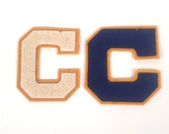 "Two Vintage Letterman ""C"" Letters White and Blue with Gold Trim"