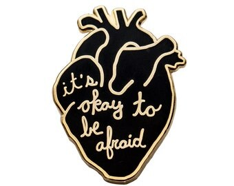 It's okay to be afraid enamel pin. Black and gold anatomical heart lapel pin. Anxiety. Handwritten.