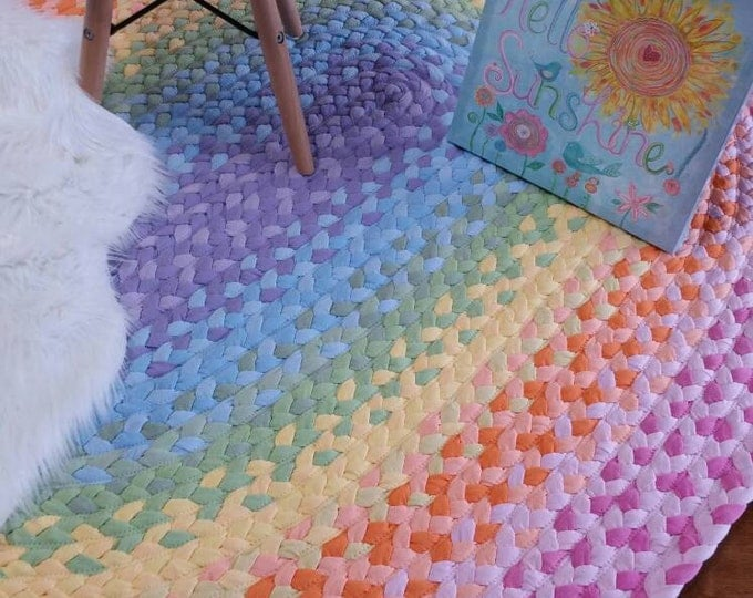 pastel rainbow braided rug , lavender, light blue, pistchio, yellow, peach  and pink