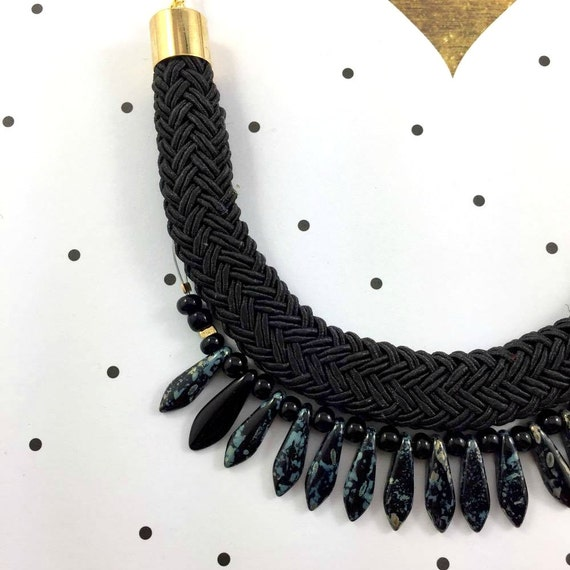 Ajustable necklace on gold color chain with black beads and on black braided polyester cord
