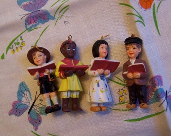 four wee carolers ornaments