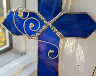 glass cross in jewel tone colors with decorative solder