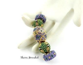 Sale - Reduced Beaded Beads set of 5 - by Sharri Moroshok - purple green gold