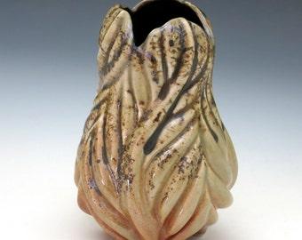 Carved porcelain leaf vase in luster shino, speckled golden orange, glossy black
