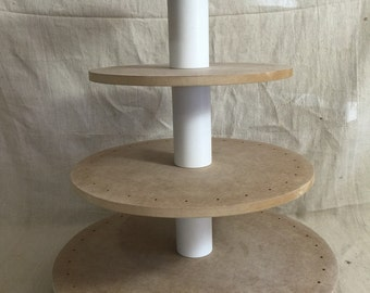 4 tier round unfinished cake pop stand with X base.  Holds up to 94 cake pops.