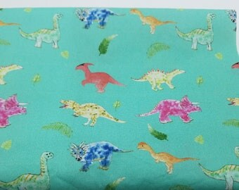 Dinosaur fabric whimsical print on teal cotton half yard Made to Order