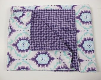 Purple, turquoise, and white baby blanket