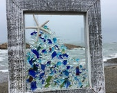 Burst of beachglass in brilliant blues with a white finger starfish