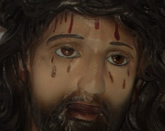 Antique image of the Holy Christ of Limpias of the 40 former Catholic religious statue with glass eyes.