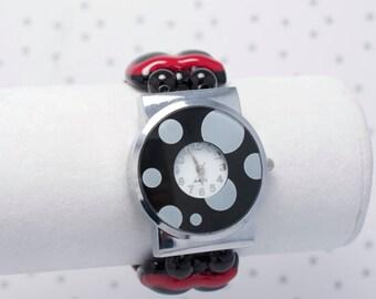 Montre bracelet en verre fusionné rouge et noire