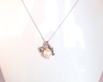 "Life at the beach charm necklace in solid sterling silver with a 18"" silver chain. Pearl is the birthstone of June."