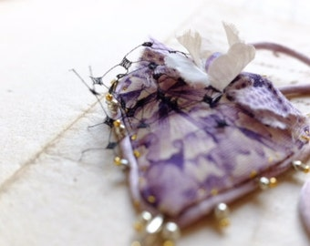 One of a kind 'Protection' Talisman necklace w/ precious antique purple fabrics, silk tulle, silk flowers, glass beads, love heart pendant