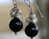 Sterling silver black onyx freshwater pearl earrings with handmade sterling french earwires. classic black and white. elegant