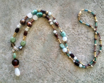 Gemstone statement necklace with garnet opal pearl turquoise and mixed metal