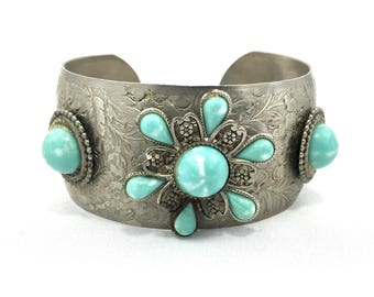 Floral Embossed 1950's blue lucite cabachon cuff bracelet