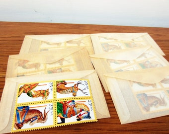 Free shipping.  1980s 25 cent stamps.  Total of 24 unused 1980s postage stamps.