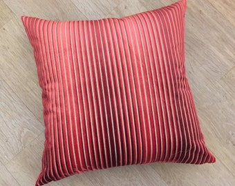Large square OMBRÉ stripe cushion cover in ruby RED and CORAL pink tones on a natural linen back ground. Fabric is Aida by Harlequin.