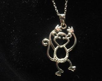 Sterling silver monkey pendant