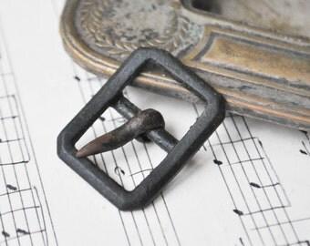 Antique belt buckle with original patina.