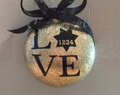 Love ornament with police badge, personalized with badge number, gold glitter filled, blue lives matter
