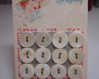 Vintage 1930's unused Luckyday pearl buttons on original card with pretty lady in green hat,12 size 22 buttons unused