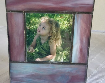 Stained glass photo frame holds image 3 1/2 x 3 1/2 inches in purples, turquoise and creams