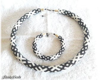 Ethnical ornament bead crochet necklace and bracelet white and hematite gray handmade unique OZOLINS pattern