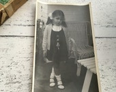 Little girl vintage photograph - dark room photography - antique photo - black and white