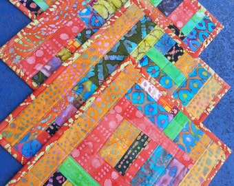 Set of four quilted placemats handmade with cotton batik fabric scraps washable reversible great gift for graduation wedding housewarming