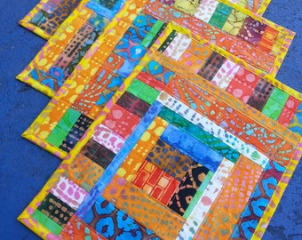 Set of four quilted placemats handmade with cotton batik fabric scraps washable reversible OOAK one of a kind modern quilt art great gifts