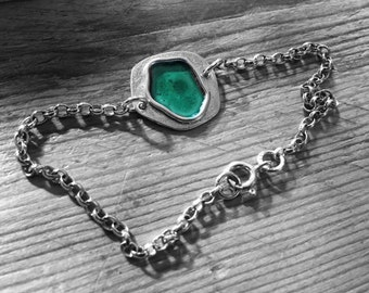 Recycled sterling silver bracelet with dark green enamel puddle detail.