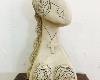 Girl wearing Her cross Clay Sculpture