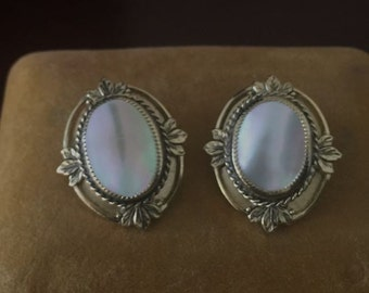 Vintage Mother of Pearl Whiting and Davis earrings in excellent condition.