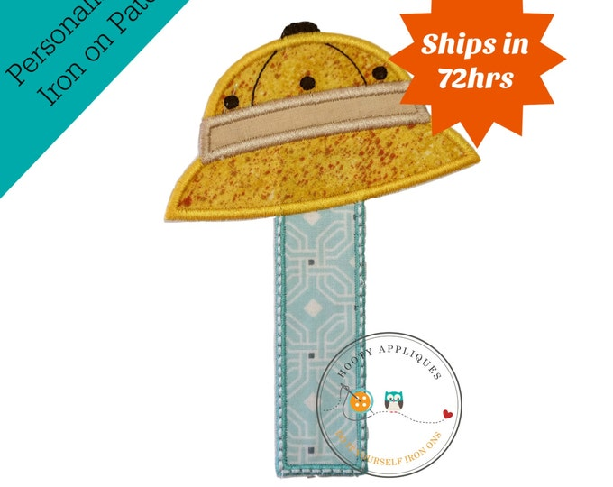Boy's first birthday safari hat iron on patch with baby blue geometric number under tilted, yellow safari hat embellished with khaki band