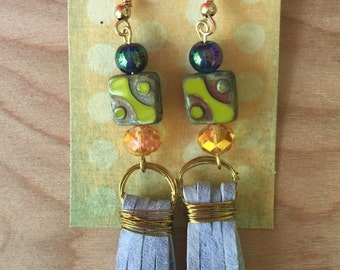One of a kind, handmade lavendar leather tassel earrings with dark blue, lime and gold beads