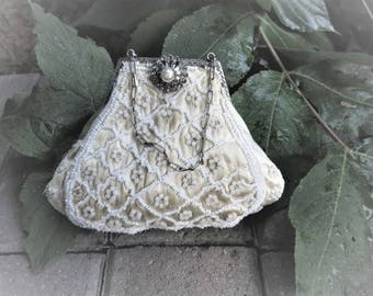 Small cream satin antique purse with pearls and a chain handle  Rhinestone and pearl clasp