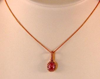 Women's 14 karat pink sapphire Oval shape diamond halo pendant 1.06 TCW