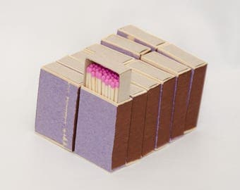 Twelve matchboxes, wooden matches with pink tips inside, striker from two sides, hanpacked item