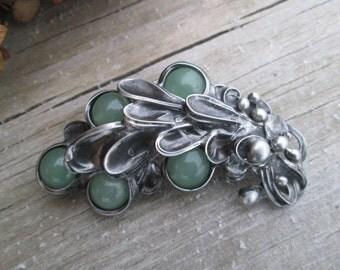 metal brooch with aventurine