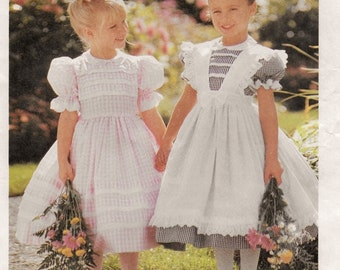 """A Short Puff Sleeve, Back Button, Full Skirt Dress and Pinafore Sewing Pattern for Girls: Uncut - Sizes 6-7-8 Breast 25""""-27"""" ~ McCall's 8697"""