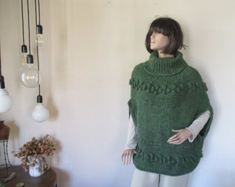 Green knitted cape-sweater is very soft and warm.