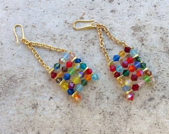 golden tone chandelier earrings, long chain dangle earrings, statement earrings with multicolored svarowski crystals and safety pins