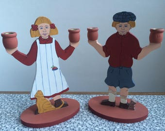 Swedish boy and girl wooden candle holders