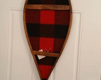 Antique wooden beavertail snowshoe, Reimagined with a vintage buffalo plaid wool blanket.  A unique piece of rustic art.