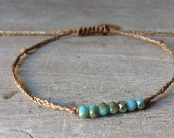 Thin dainty braided bracelet 7 faceted aqua blue tiny beads neutral wax polyester cord bracelet