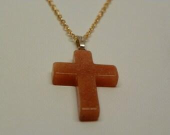 Peach stone cross on gold chain(N1)