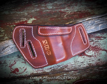 Custom conceal and carry leather holster with namer initials comes in many colors.