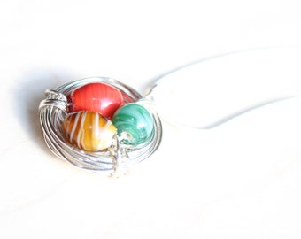 "Birds Nest Necklace - wire wrapped pendant with three glass ""eggs"" May, July, November"
