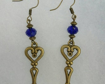 Handmade bronze key dangle earrings with royal blue facetted glass beads